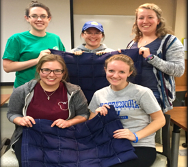 OTI members donate blankets to children in Jamaica!