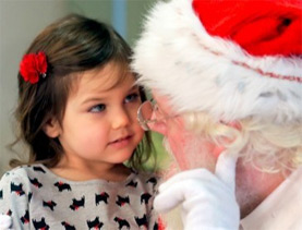 Santa Claus greeting child