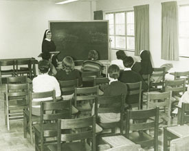 Students studying the renal system with Sister Hope Vahey at College Misericordia, circa 1970s