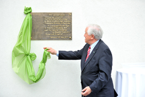 Dr. Dudrick removes a drapery to unveil a plaque that names a 28-bed hospital in the town of Skawina, Poland in his honor. Stanley J. Dudrick Hospital was officially dedicated in May, 2012.